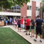 Students line up outside Kurz Hall awaiting room assignments.