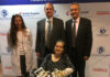 Louella Aker is seated with from left, Christine Kaufman, Ph.D., Stuart Williams, Ph.D., and Tuna Ozyurekoglu, M.D. Aker is the recipient of the first double hand transplant with a woman in Kentucky.