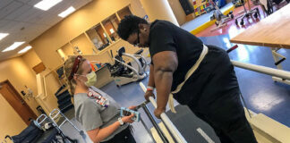 patient undergoes physical therapy in a hospital rehab room