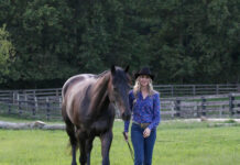 Elizabeth James, Ph.D., with her horse, Ozzie. (Photo by Alaina Alderman)